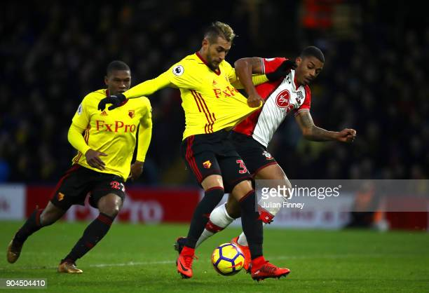Roberto Pereyra of Watford is challenged by Mario Lemina of Southampton during the Premier League match between Watford and Southampton at Vicarage...