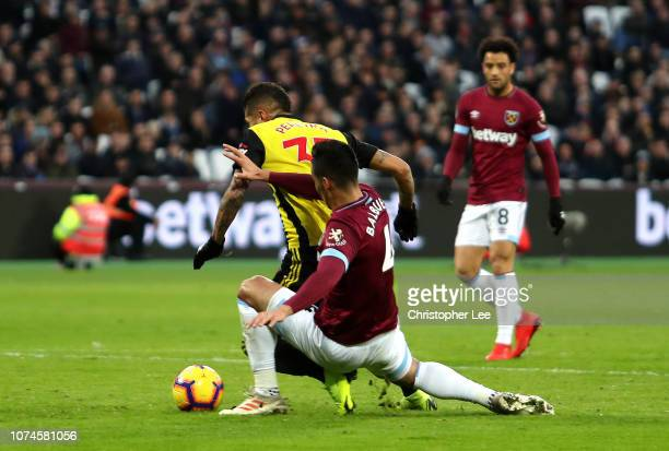 Roberto Pereyra of Watford is fouled by Fabian Balbuena of West Ham United and a penalty is awarded during the Premier League match between West Ham...