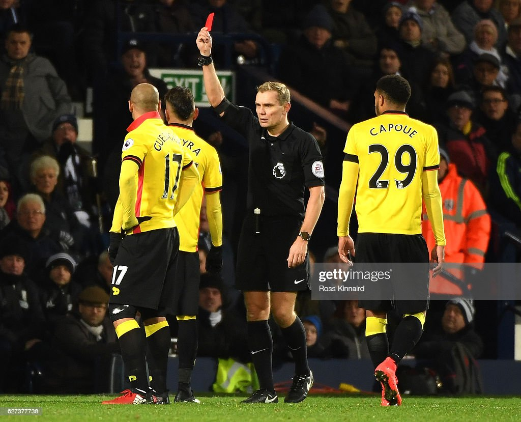 Roberto Pereyra (2nd L) of Watford is shown a red card by referee Graham Scott (2nd R) during the Premier League match between West Bromwich Albion and Watford at The Hawthorns on December 3, 2016 in West Bromwich, England.