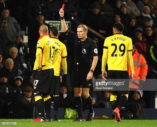 Roberto Pereyra of Watford is shown a red card by referee Graham Scott during the Premier League match between West Bromwich Albion and Watford at...