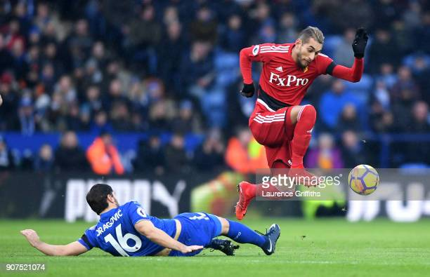 Roberto Pereyra of Watford is tackled by Aleksander Dragovic of Leicester City during the Premier League match between Leicester City and Watford at...