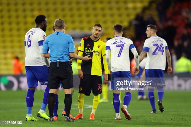 Roberto Pereyra of Watford reacts to Kieron Morris of Tranmere Rovers after receiving a red card during the FA Cup Third Round match between Watford...