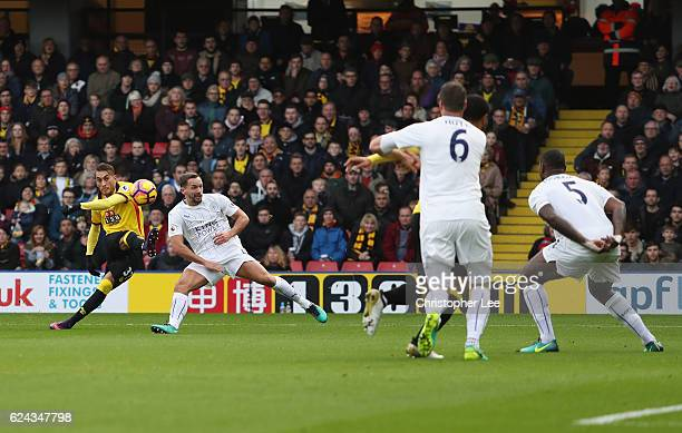 Roberto Pereyra of Watford scores his sides second goal during the Premier League match between Watford and Leicester City at Vicarage Road on...