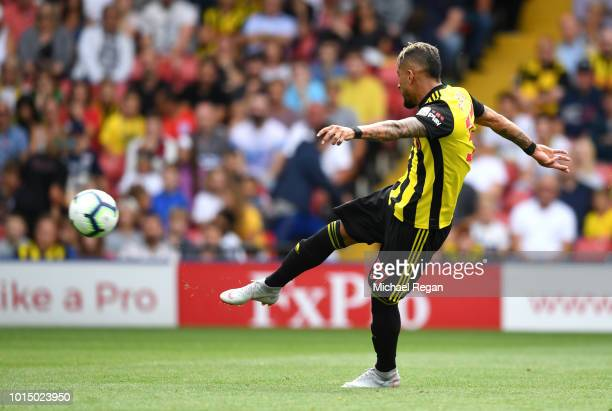 Roberto Pereyra of Watford scores his team's first goal during the Premier League match between Watford FC and Brighton Hove Albion at Vicarage Road...