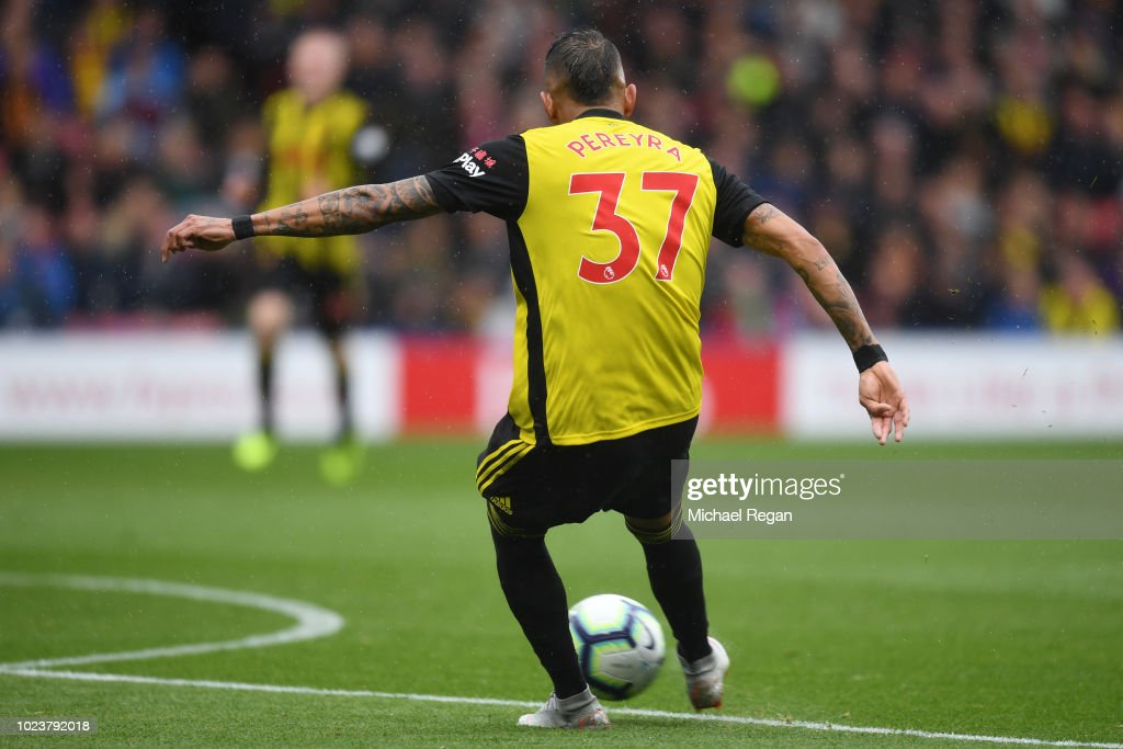 Roberto Pereyra of Watford scores his team's first goal during the Premier League match between Watford FC and Crystal Palace at Vicarage Road on August 26, 2018 in Watford, United Kingdom.