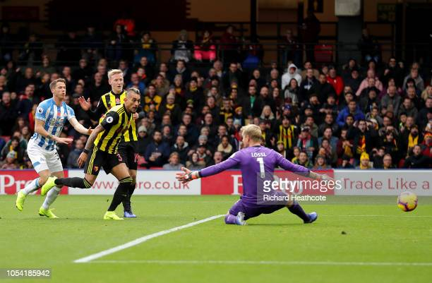 Roberto Pereyra of Watford scores his team's first goal past Jonas Lossl of Huddersfield Town during the Premier League match between Watford FC and...