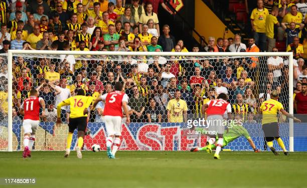 Roberto Pereyra of Watford scores his team's second goal from a penalty past Bernd Leno of Arsenal during the Premier League match between Watford FC...