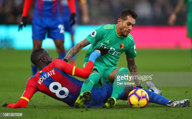 Roberto Pereyra of Watford tangles with Cheikhou Kouyate of Crystal Palace during the Premier League match between Crystal Palace and Watford FC at...