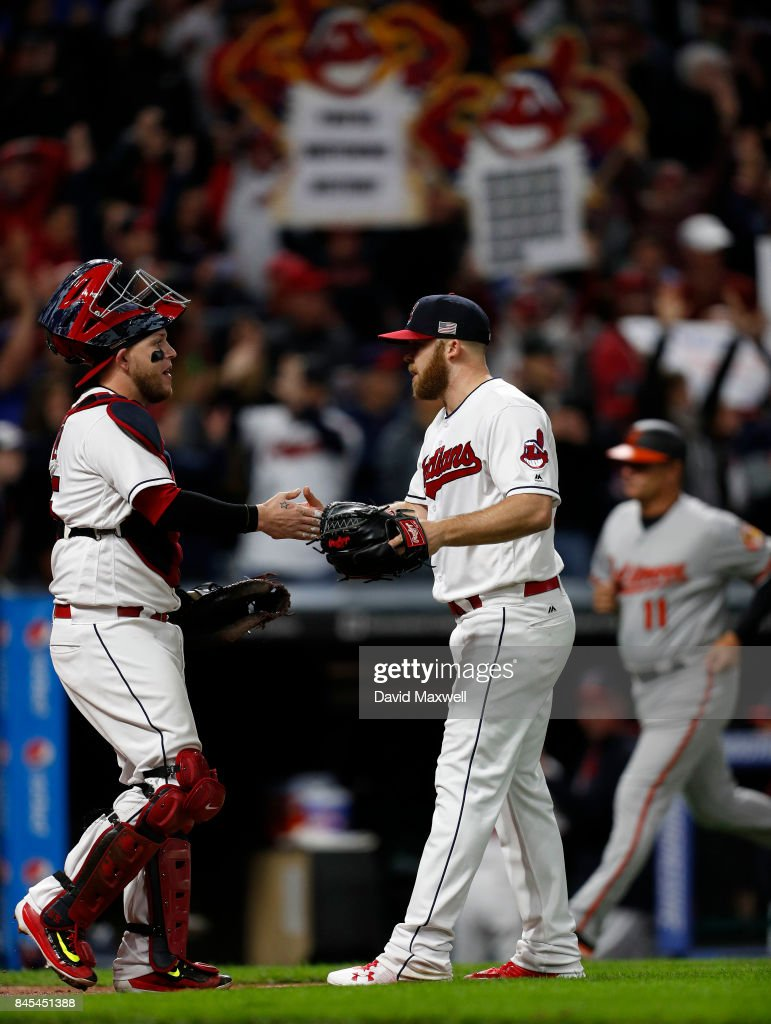Roberto Perez #55 and Cody Allen #37 of the Cleveland Indians celebate after the final out of the game against the Baltimore Orioles at Progressive Field on September 10, 2017 in Cleveland, Ohio. The Indians defeated the Orioles 3-2, and their win streak now stands at 18.
