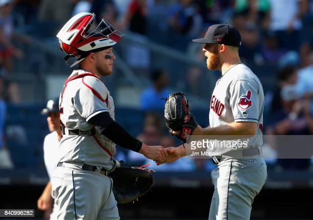 Roberto Perez and Cody Allen of the Cleveland Indians celebrate after defeatimng the New York Yankees in the first game of a doubleheader at Yankee...