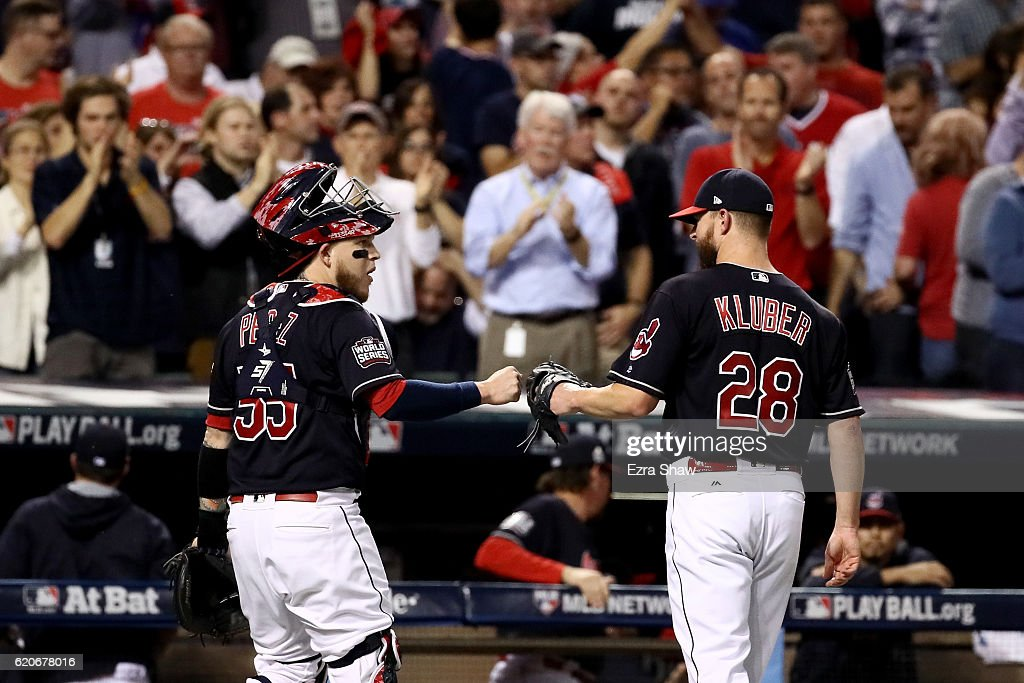 Roberto Perez #55 and Corey Kluber #28 of the Cleveland Indians react after the top of the first inning against the Chicago Cubs in Game Seven of the 2016 World Series at Progressive Field on November 2, 2016 in Cleveland, Ohio.