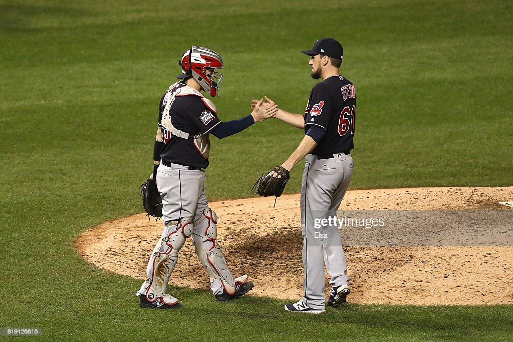 Roberto Perez #55 and Dan Otero #61 of the Cleveland Indians celebrate after beating the Chicago Cubs 7-2 in Game Four of the 2016 World Series at Wrigley Field on October 29, 2016 in Chicago, Illinois.