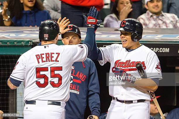 Roberto Perez celebrates with Giovanny Urshela of the Cleveland Indians after Perez hit a two run hoe run during the seventh inning against the...