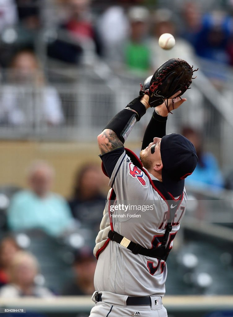 Roberto Perez #55 of the Cleveland Indians catches a foul ball hit by Brian Dozier #2 of the Minnesota Twins during the first inning in game two of a doubleheader on August 17, 2017 at Target Field in Minneapolis, Minnesota.