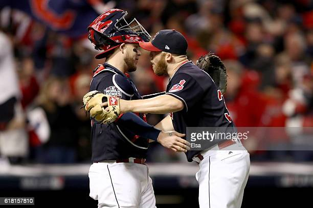 Roberto Perez of the Cleveland Indians celebrates with Cody Allen after defeating the Chicago Cubs 60 in Game One of the 2016 World Series at...