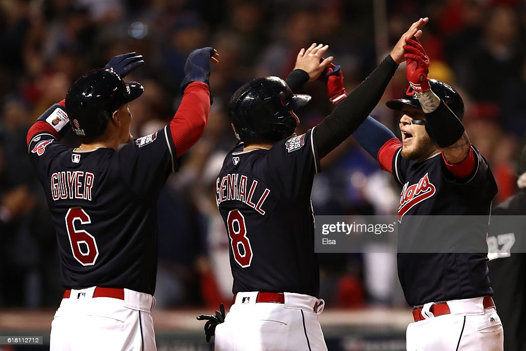 Roberto Perez #55 of the Cleveland Indians celebrates with Lonnie Chisenhall #8 and Brandon Guyer #6 after hitting a three-run home run during the eighth inning against the Chicago Cubs in Game One of the 2016 World Series at Progressive Field on October 25, 2016 in Cleveland, Ohio.