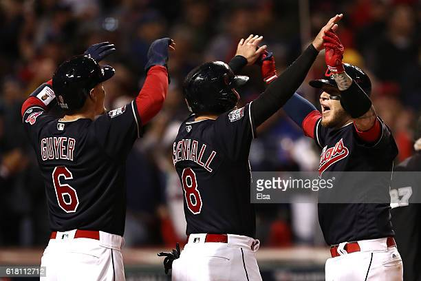 Roberto Perez of the Cleveland Indians celebrates with Lonnie Chisenhall and Brandon Guyer after hitting a threerun home run during the eighth inning...