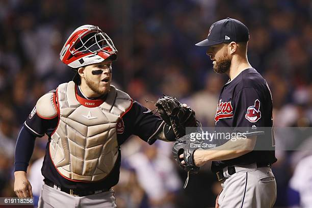 Roberto Perez of the Cleveland Indians congratulates Corey Kluber at the end of the first inning against the Chicago Cubs in Game Four of the 2016...