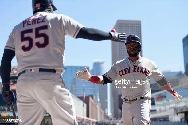 Roberto Perez of the Cleveland Indians congratulates teammate Hanley Ramirez on a solo home run against the Cleveland Indians during the fourth...