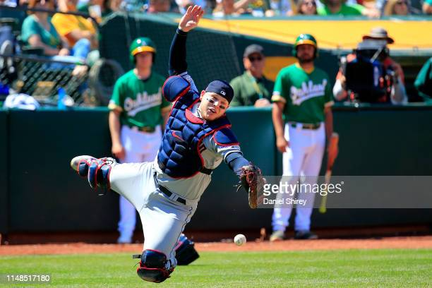 Roberto Perez of the Cleveland Indians fails to catch a pop fly during the sixth inning against the Oakland Athletics at OaklandAlameda County...