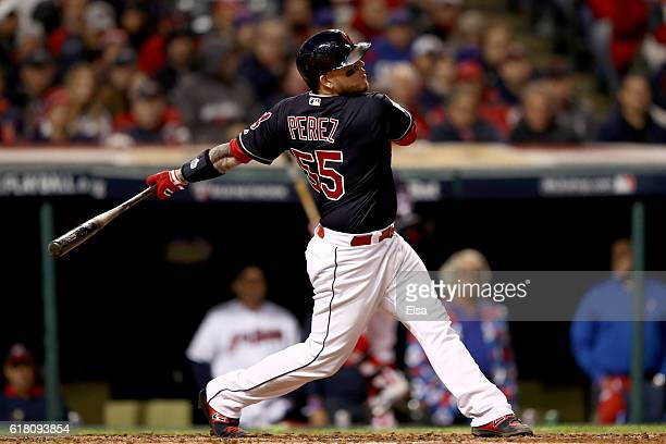 Roberto Perez of the Cleveland Indians hits a solo home run during the fourth inning against the Chicago Cubs in Game One of the 2016 World Series at...
