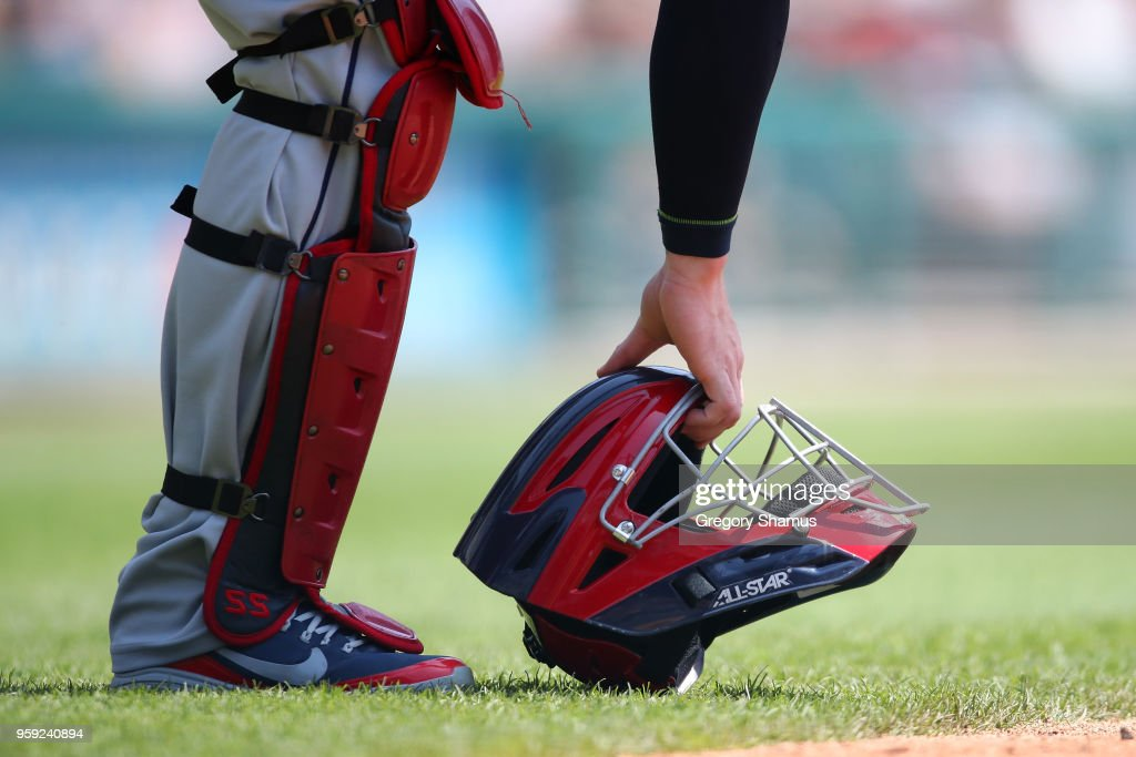Roberto Perez #55 of the Cleveland Indians picks up his helmet in the second inning while playing the Detroit Tigers at Comerica Park on May 16, 2018 in Detroit, Michigan.