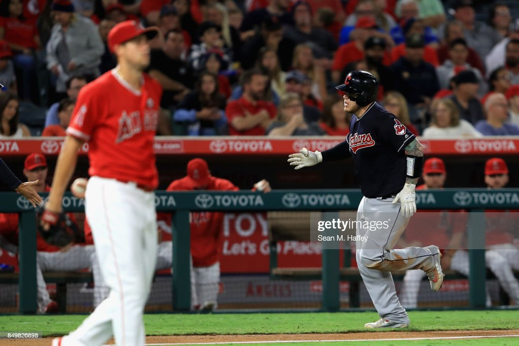 Roberto Perez #55 of the Cleveland Indians rounds third base after hitting a solo homerun as Tyler Skaggs #45 of the Los Angeles Angels of Anaheim looks on during the fifth inning of a game at Angel Stadium of Anaheim on September 19, 2017 in Anaheim, California.