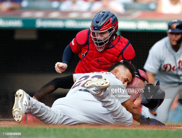 Roberto Perez of the Cleveland Indians tags out Victor Reyes of the Detroit Tigers attempting to score on a double by Harold Castro during the first...