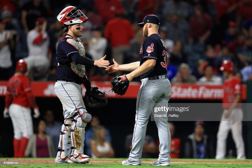 Roberto Perez #55 shakes hands with Cody Allen #37 of the Cleveland Indians after defeating the Los Angeles Angels of Anaheim 6-3 in a game at Angel Stadium of Anaheim on September 19, 2017 in Anaheim, California.