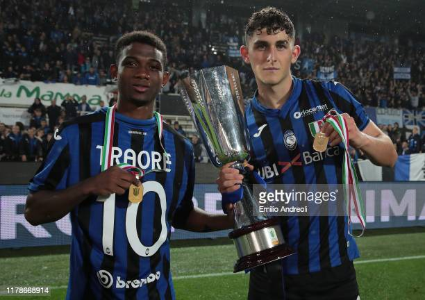 Roberto Piccoli and Amad Traore of Atalanta Bc celebrate with the trophy the victory of the Primavera Tim Supercup at the end of the Primavera TIM...