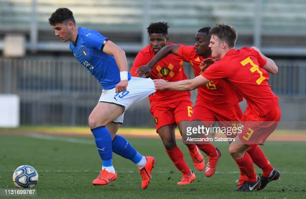 Roberto Piccoli of Italy U19 competes for the ball with Joren Leyssens of Belgium U19 during the UEFA Elite Round match between Italy U19 and Belgium...
