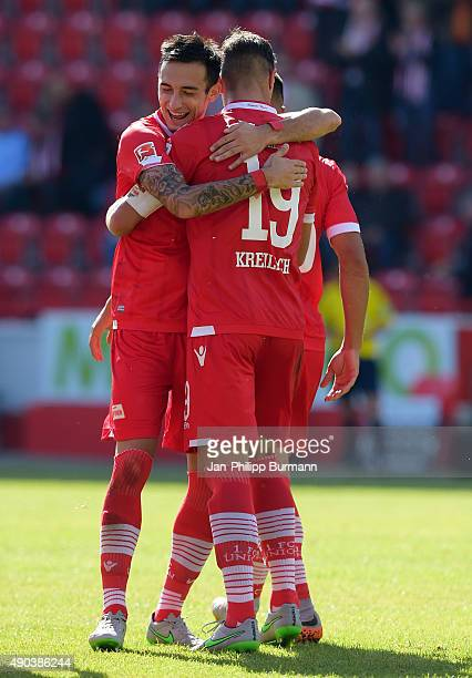 Roberto Puncec and Damir Kreilach of 1 FC Union Berlin celebrate after scoring the 30 during the game between Union Berlin and MSV Duisburg on...