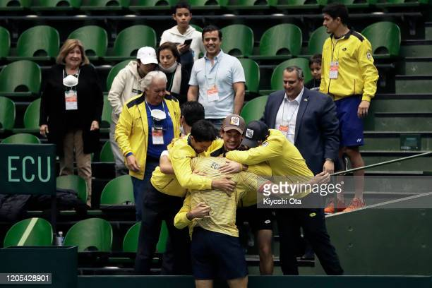 Roberto Quiroz of Ecuador celebrates with his team mates after winning his singles match against Yasutaka Uchiyama of Japan on day one of the Davis...
