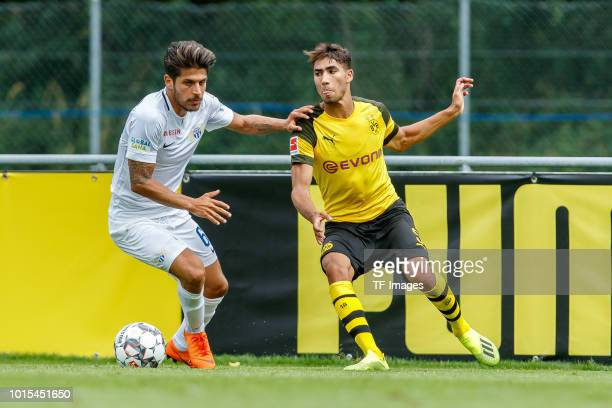 Roberto Rodriguez of FC Zuerich and Achraf Hakimi of Dortmund battle for the ball during the friendly match between Borussia Dortmund and FC Zuerich...