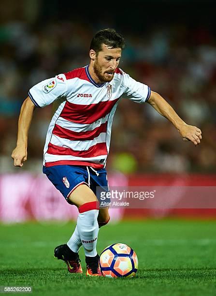 Roberto Roman Triguero of Granada FC in action during a friendly match between Granada FC and Sevilla FC at Estadio Nuevo los Carmenes on August 2...
