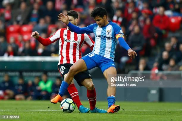 Roberto Rosales of Malaga CF Aritz Aduriz of Athletic Bilbao during the La Liga Santander match between Athletic de Bilbao v Malaga at the Estadio...