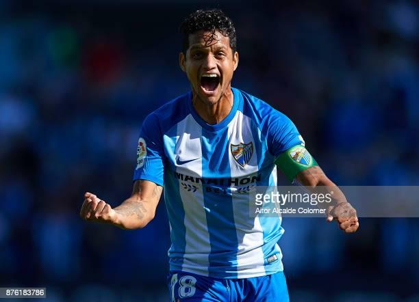 Roberto Rosales of Malaga CF celebrates after scoring the first goal for Malaga CF during the La Liga match between Malaga and Deportivo La Coruna at...