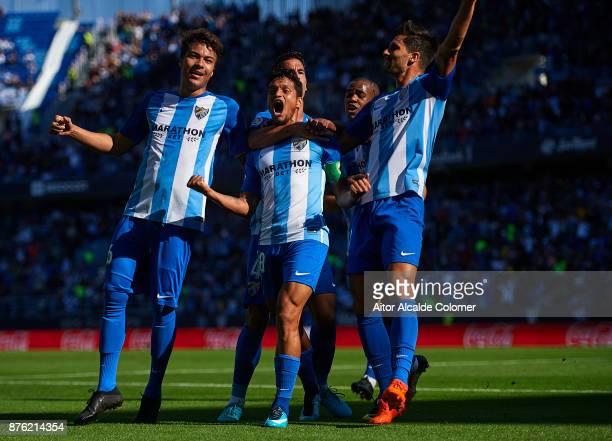 Roberto Rosales of Malaga CF celebrates after scoring the first goal for Malaga CF with Adalberto Penaranda of Malaga CF and Adrian Gonzalez of...