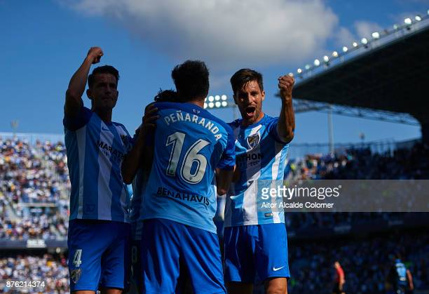 Roberto Rosales of Malaga CF celebrates after scoring the first goal for Malaga CF with Luis Hernandez of Malaga CF Adalberto Penaranda of Malaga CF...