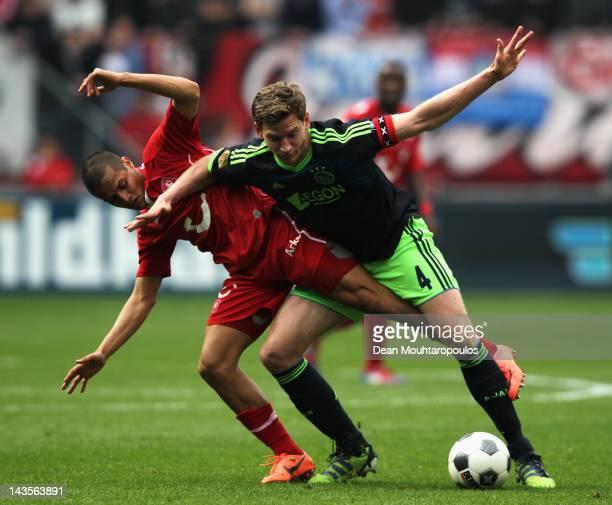 Roberto Rosales of Twente is beaten by Jan Vertonghen of Ajax during the Eredivisie match between FC Twente and Ajax Amsterdam at De Grolsch Veste...