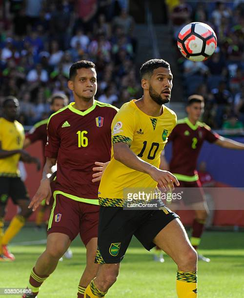 Roberto Rosales of Venezuela and Jobi McAnuff of Jamaica fight for the ball during a group C match between Jamaica and Venezuela at Soldier Field...