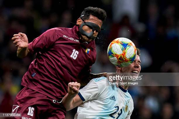 Roberto Rosales of Venezuela is challenged by juan Marcos Foyth of Argentina during the international friendly match between Argentina and Venezuela...
