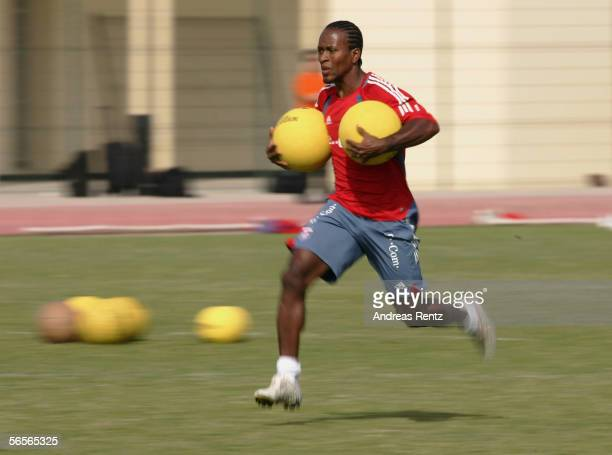 Z Roberto runs with medicine balls in the morning session during the training camp of German Bundesliga club Bayern Munich on January 11 2006 in...