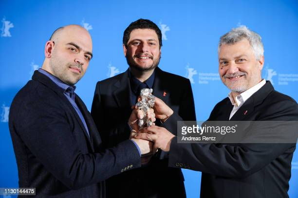 Roberto Saviano Claudio Giovannesi and Maurizio Braucci winner of the Silver Bear for Best Screenplay for Piranhas pose at the closing ceremony of...
