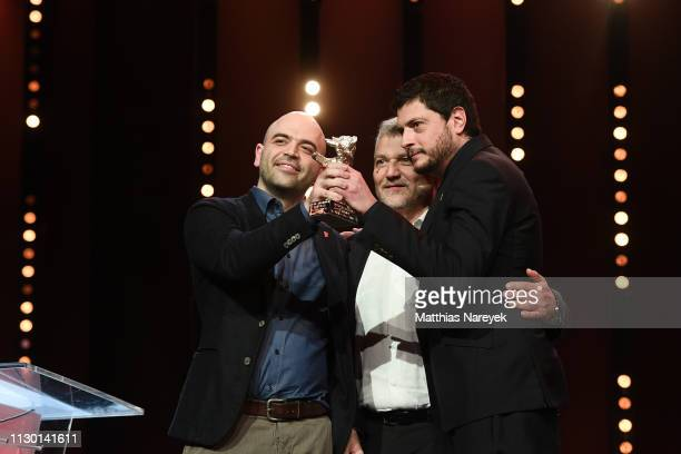 Roberto Saviano Maurizio Braucci and Claudio Giovannesi winner of the Silver Bear for Best Screenplay are seen on stage at the closing ceremony of...