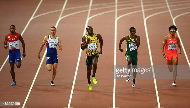 Roberto Skyers of Cuba Daniel Talbot of Great Britain Usain Bolt of Jamaica Anaso Jobodwana of South Africa and Kenji Fujimitsu of Japan compete in...