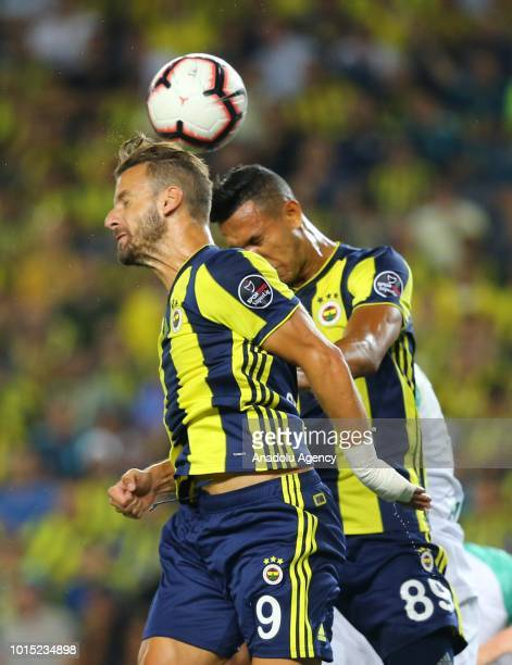 Roberto Soldado and Josef De Souza of Fenerbahce in action during the Turkish Super Lig match between Fenerbahce and Bursaspor at Ulker Stadium in...