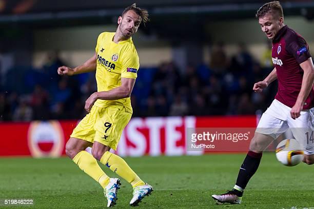09 Roberto Soldado del Villarreal CF and 14 Martin Frydek of AC Sparta Prague during UEFA Europa League quarterfinals first leg match between...