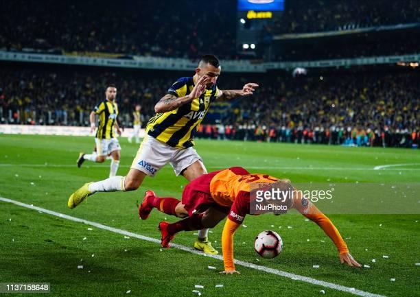 Roberto Soldado of Fenerbache fouling Semih Kaya of Galatasaray during the Turkish Super Lig match between Fenerbache and Galatasaray at the ükrü...