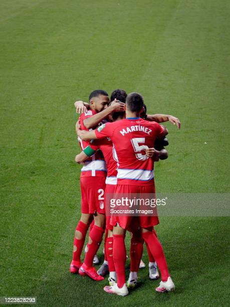 Roberto Soldado of Granada celebrates 20 with Dimitri Foulquier of Granada Jose Martinez of Granada during the La Liga Santander match between...